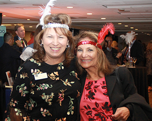 Martha Martinez and Ofelia Lariviere get into the spirit of the Roaring '20s themed reception.