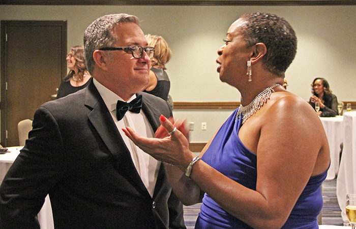 ACSA Executive Director Wes Smith chats with Valuing Diversity Award winner Michele Bowers.
