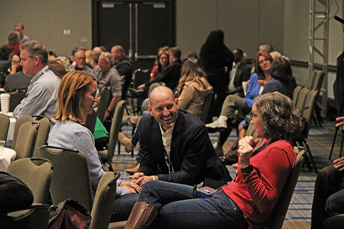 Attendees discuss a topic during Roni Habib's keynote.